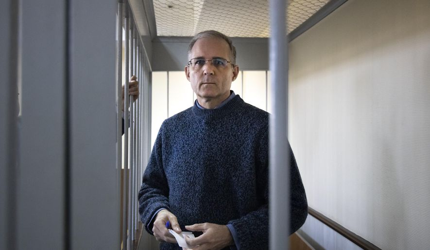 Paul Whelan, a former U.S. Marine, who was arrested for alleged spying in Moscow at the end of 2018, stands in a cage while waiting for a hearing in a courtroom in Moscow, Russia, Friday, Aug. 23, 2019. (AP Photo/Alexander Zemlianichenko) ** FILE **