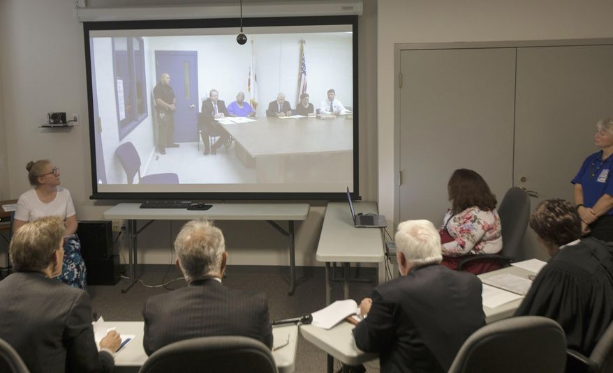 Samuel Little pleas guilty to killing two women in Cincinnati in the 1980s while appearing via Skype from the California state prison to the Hamilton County Courthouse in Cincinnati on Friday, Aug. 23, 2019.  Authorities have said they have confirmed at least 60 of the 93 slayings he says he committed in 14 states while he crisscrossed the country for decades. (Albert Cesare /The Cincinnati Enquirer via AP)