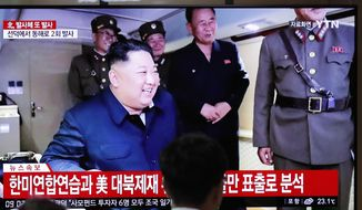 People watch a TV news program reporting North Korea's firing of projectiles with a file image of North Korean leader Kim Jong-un at the Seoul Railway Station in Seoul, South Korea, Saturday, Aug. 24, 2019. (AP Photo/Lee Jin-man) ** FILE **