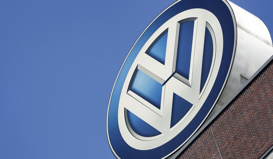FILE - In this Wednesday, Aug. 1, 2018 file photo, the logo of Volkswagen is seen on top of a company building in Wolfsburg, Germany.  Volkswagen is recalling about 679,000 cars in the U. S. to fix a problem that could let the cars to roll away unexpectedly. The recall covers certain 2011 through 2018 Jettas; 2015 through 2019 GTIs; 2015, 2016, 2018 and 2019 Golfs; 2012 through 2019 Beetles and Beetle Convertibles; and 2017 through 2019 Golf SportWagens.   (AP Photo/Michael Sohn, file)