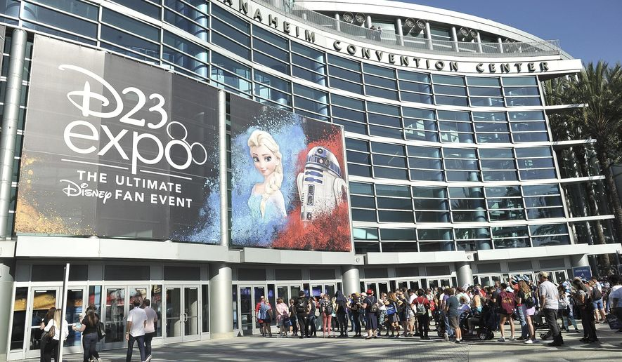 People line up in front of the Anaheim Convention Center during the 2019 D23 Expo on Saturday, Aug. 24, 2019, in Anaheim, Calif. (Photo by Richard Shotwell/Invision/AP)