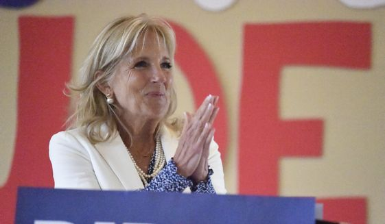 "Joe Biden's wife, Jill, said her husband might not be the best candidate, but hey, she told voters, ""maybe you have to swallow a little bit"" and vote for him anyway. (Associated Press/File)"