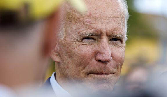 Former Vice President Joseph R. Biden appears to be the sacrificial Democrat in a massive international cover-up. (Associated Press/File)