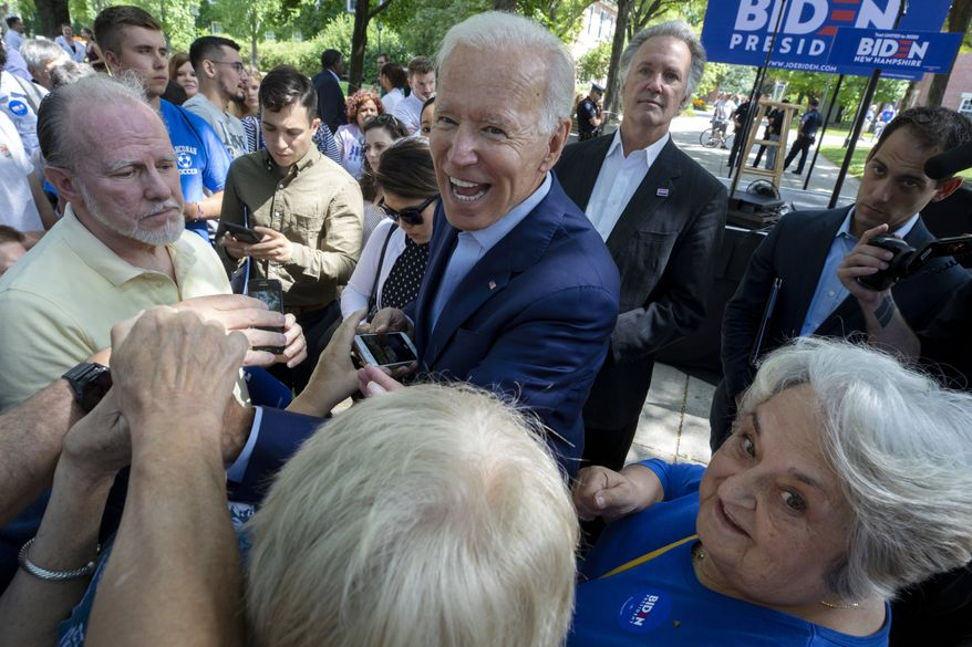 Democratic presidential candidate former Vice President Joe Biden greets supporters during a campaign event at Keene State College in Keene N.H., Saturday, Aug. 24, 2019. (AP Photo/Michael Dwyer)
