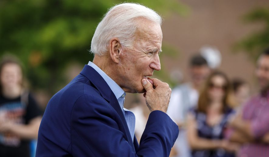 Democratic presidential candidate former Vice President Joe Biden approaches reporters to answer questions following a campaign stop at Lindy's Diner in Keene, N.H., Saturday, Aug. 24, 2019. (AP Photo/Michael Dwyer)