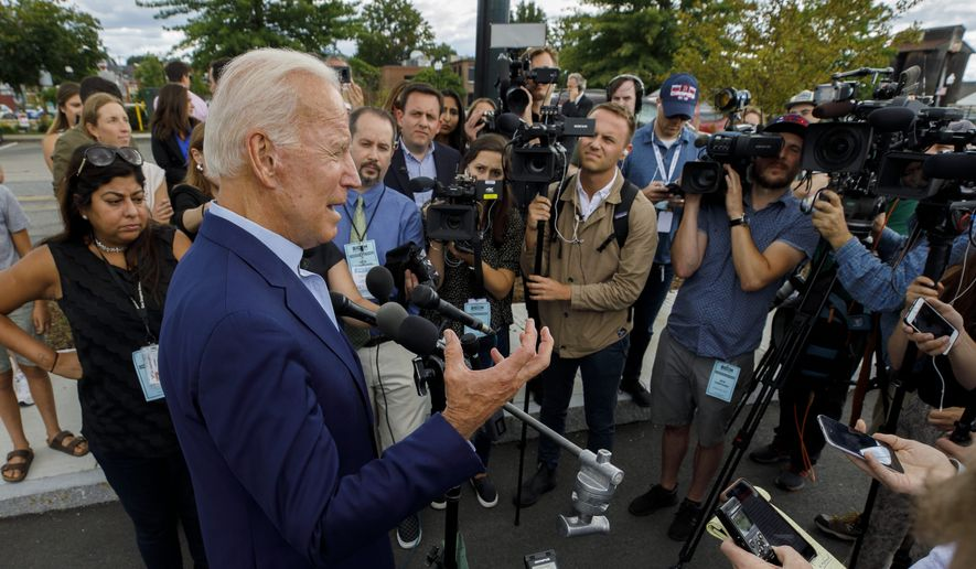 Democratic presidential candidate former Vice President Joe Biden speaks to reporters after a campaign stop at Lindy's Diner in Keene N.H., Saturday, Aug. 24, 2019. (AP Photo/Michael Dwyer)