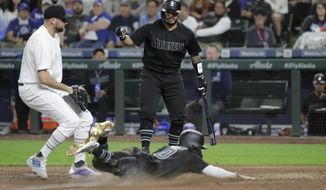 Seattle Mariners' Omar Narvaez, right, watches as Mallex Smith scores on a wild pitch by Toronto Blue Jays' Tim Mayza, left, during the sixth inning of a baseball game Friday, Aug. 23, 2019, in Seattle. (AP Photo/Ted S. Warren)