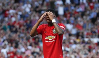 Manchester United's Marcus Rashford reacts after missing to score on a penalty kick during the English Premier League soccer match between Manchester United and Crystal Palace at Old Trafford in Manchester, England Saturday, Aug, 24, 2019. (AP Photo/Alastair Grant)