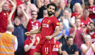 Liverpool's Mohamed Salah celebrates scoring during the English Premier League soccer match against Arsenal at Anfield, Liverpool, England, Saturday Aug. 24, 2019. (Anthony Devlin/PA via AP)