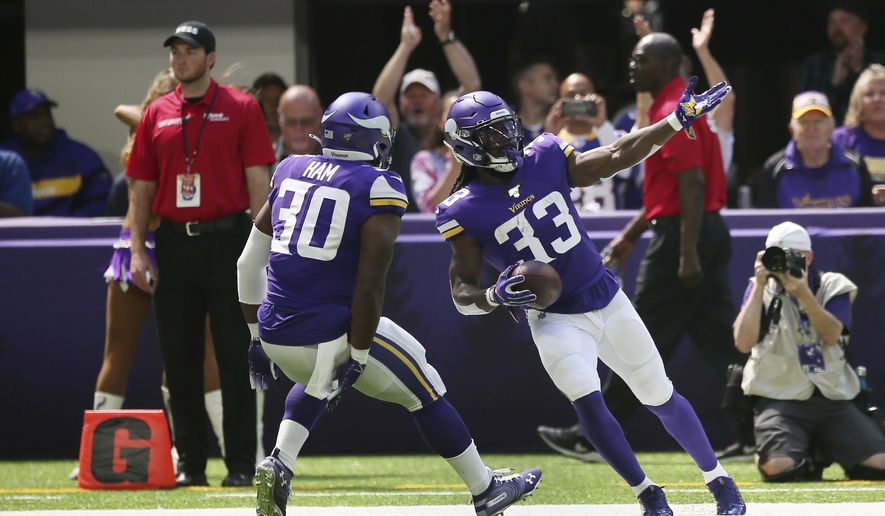 Minnesota Vikings running back Dalvin Cook celebrates with teammate CJ Ham (30) after scoring on an 85-yard touchdown run in the first half of an NFL preseason football game against the Arizona Cardinals, Saturday, Aug. 24, 2019, in Minneapolis. (AP Photo/Jim Mone)