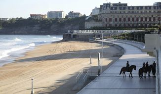 Mounted police officers patrol near the beach on the first day of the G-7 summit in Biarritz, France Saturday, Aug. 24, 2019. U.S. President Donald Trump and the six other leaders of the Group of Seven nations will begin meeting Saturday for three days in the southwestern French resort town of Biarritz. France holds the 2019 presidency of the G-7, which also includes Britain, Canada, Germany, Italy and Japan. (AP Photo/Markus Schreiber)