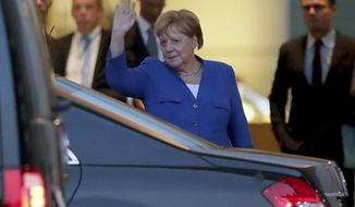 German Chancellor Angela Merkel waves goodbye as Britain's Prime Minister Boris Johnson leaves after a meeting at the Chancellery in Berlin, Germany, Wednesday, Aug. 21, 2019. (AP Photo/Michael Sohn)