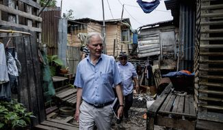 """In this hand out picture taken Friday, Aug. 16, 2019, show Philip Alston, the U.N. rapporteur on extreme poverty and human rights, visiting Kampung Numbak in Sabab, east of Malaysia. Alston said Malaysia's official poverty rate, which fell from 49 percent in 1970 to just 0.4 percent in 2016, was """"extremely artificial"""" and doesn't reflect the cost of living and excluded vulnerable populations. (Bassam Khawaja via AP)"""