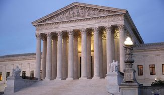 In this May 23, 2019 file photo, the U.S. Supreme Court building at dusk on Capitol Hill in Washington.   (AP Photo/Patrick Semansky, File) **FILE**
