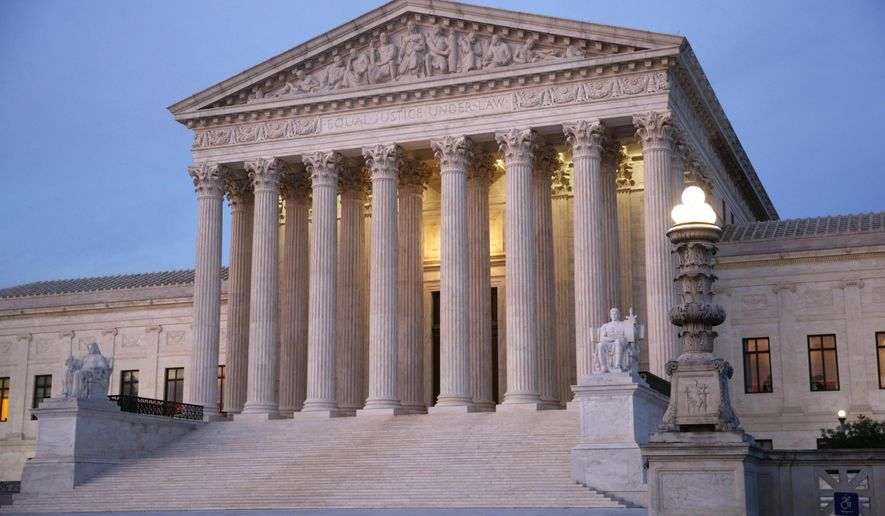 The U.S. Supreme Court building at dusk on Capitol Hill in Washington.   (AP Photo/Patrick Semansky, File) **FILE**