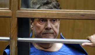 FILE - In this July 1, 2019, file photo, Dr. George Tyndall, 72, listens during an arraignment at Los Angeles Superior court in Los Angeles. The former University of Southern California gynecologist charged with sexually abusing patients has posted bail and been released from jail. The Los Angeles Times reports Dr. George Tyndall was freed Friday evening, Aug. 23, 2019, on $160,000 bond. Tyndall was arrested in June on 29 felony counts and faces up to 53 years in prison if convicted on all charges. He has denied any wrongdoing. (AP Photo/Richard Vogel, File)