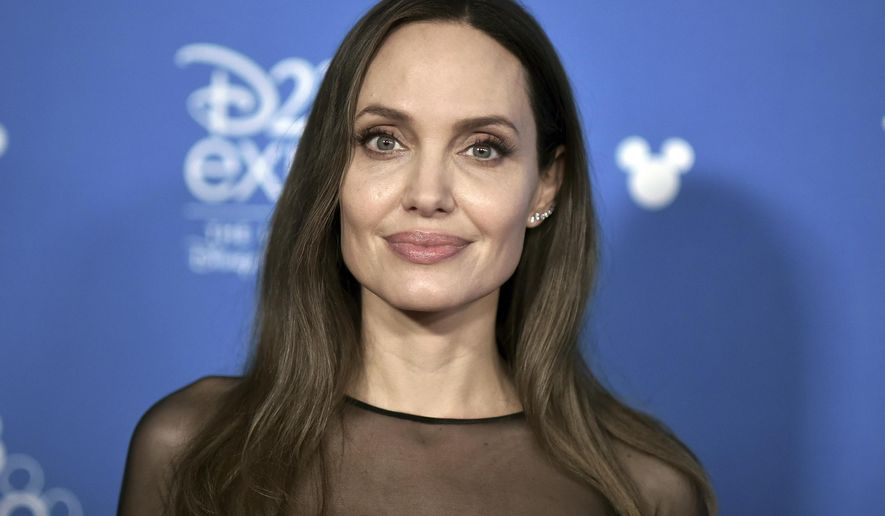 """Angelina Jolie attends the """"Go Behind the Scenes with the Walt Disney Studios,"""" press line at the 2019 D23 Expo, Saturday, Aug. 24, 2019, in Anaheim, Calif. (Photo by Richard Shotwell/Invision/AP)"""