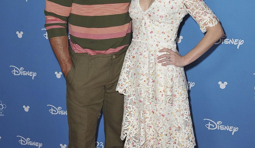 Dwayne Johnson, left, and Emily Blunt attend the Go Behind the Scenes with the Walt Disney Studios press line at the 2019 D23 Expo on Saturday, Aug. 24, 2019, in Anaheim, Calif. (Photo by Richard Shotwell/Invision/AP)