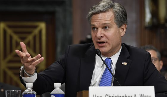 FBI Director Christopher A. Wray singled out China's Thousand Talents Plan during testimony to the Senate last month. While acknowledging the plan isn't inherently illegal, Mr. Wray said FBI investigations have uncovered cases in which it was used to flow U.S. intellectual property to China. (Associated Press photograph)
