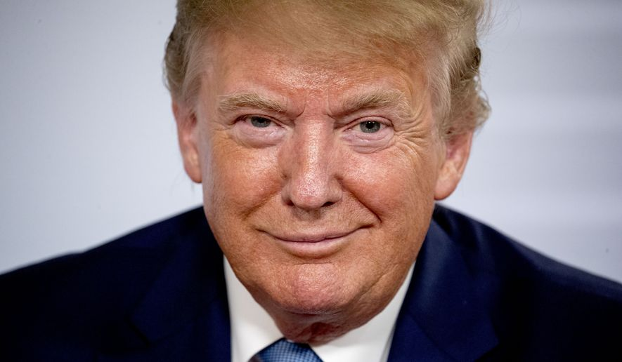 U.S President Donald Trump smiles during a news conference with Japanese Prime Minister Shinzo Abe at the G-7 summit in Biarritz, France, Sunday, Aug. 25, 2019, where they announced that the U.S. and Japan have agreed in principle on a new trade agreement. (AP Photo/Andrew Harnik)