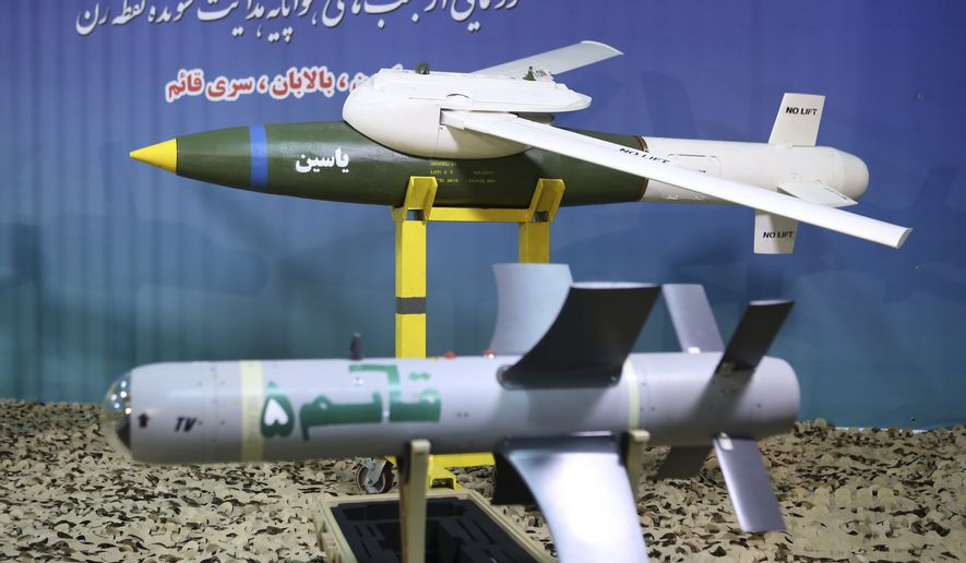 "This photo released by the official website of the Iranian Defense Ministry on Aug. 8, 2019, shows Iranian-made smart bombs during an unveiling ceremony, Iran. The semi-official ILNA news agency quoted Iranian Gen. Mohsen Rezaei on Sunday, Aug. 25, 2019, as denying claims by the Israeli military that it thwarted an imminent Iranian drone attack on Israel, calling that a ""lie."" (Iranian Defense Ministry via AP)"