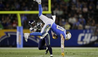 Los Angeles Chargers tight end Sean Culkin, right, is tackled by Seattle Seahawks cornerback Jamar Taylor during the second half of an NFL preseason football game Saturday, Aug. 24, 2019, in Carson, Calif. (AP Photo/Gregory Bull)