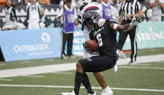 Arizona safety Scottie Young Jr. (6) can't stop Hawaii wide receiver Cedric Byrd II (6) from making a first-quarter touchdown during an NCAA college football game Saturday, Aug. 24, 2019, in Honolulu. (AP Photo/Marco Garcia)