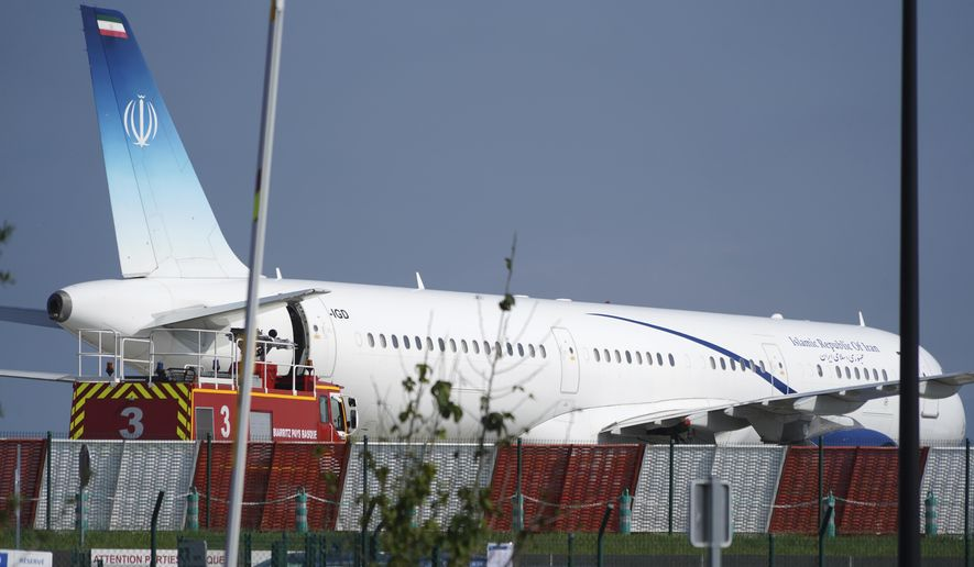 Aan Iranian plane can be seen at the airport in Biarritz, France Sunday, Aug. 25, 2019. Iranian Foreign Minister Mohammad Javad paid an unannounced visit Sunday to the G-7 summit and headed straight to the building where leaders of the world's major democracies have been debating how to handle the country's nuclear ambitions. The surprise arrival of Zarif came just two days after his meeting with France's president, who is the host of the Group of Seven gathering in Biarritz. (AP Photo/Mstyslav Chernov)