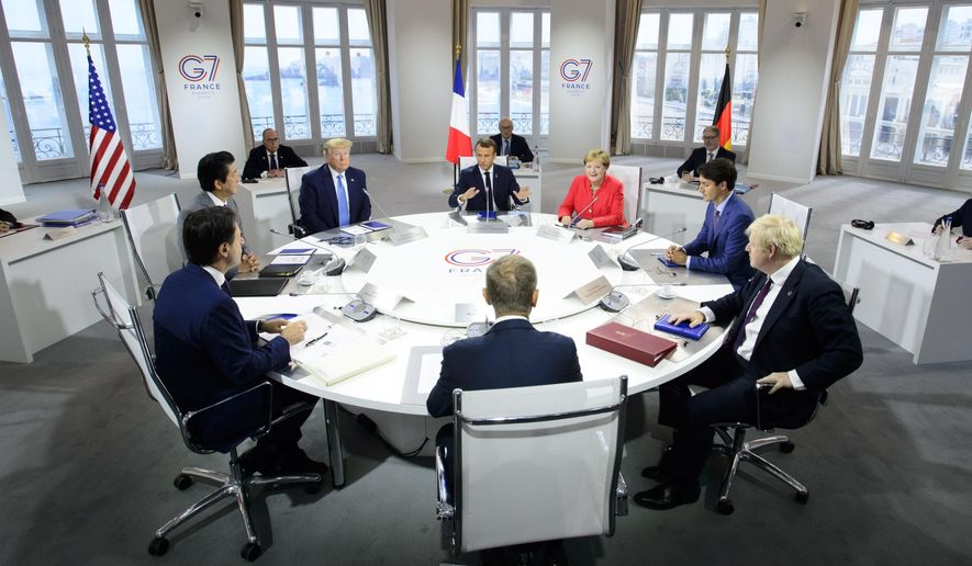 President of the European Council Donald Tusk, clockwise from center front, Italian Prime Minister Giuseppe Conte, Japan Prime Minister Shinzo Abe, U.S. President Donald Trump, President of France Emmanuel Macron, German Chancellor Angela Merkel, Canadian Prime Minister Justin Trudeau, and British Prime Minister Boris Johnson take part in a working session with G7 leaders on the second day of the G-7 summit in Biarritz, France Sunday, Aug. 25, 2019. (Sean Kilpatrick/The Canadian Press via AP)