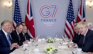 President Donald Trump and Britain's Prime Minister Boris Johnson, right, attend a working breakfast at the Hotel du Palais on the sidelines of the G-7 summit in Biarritz, France, Sunday, Aug. 25, 2019. (AP Photo/Andrew Harnik)