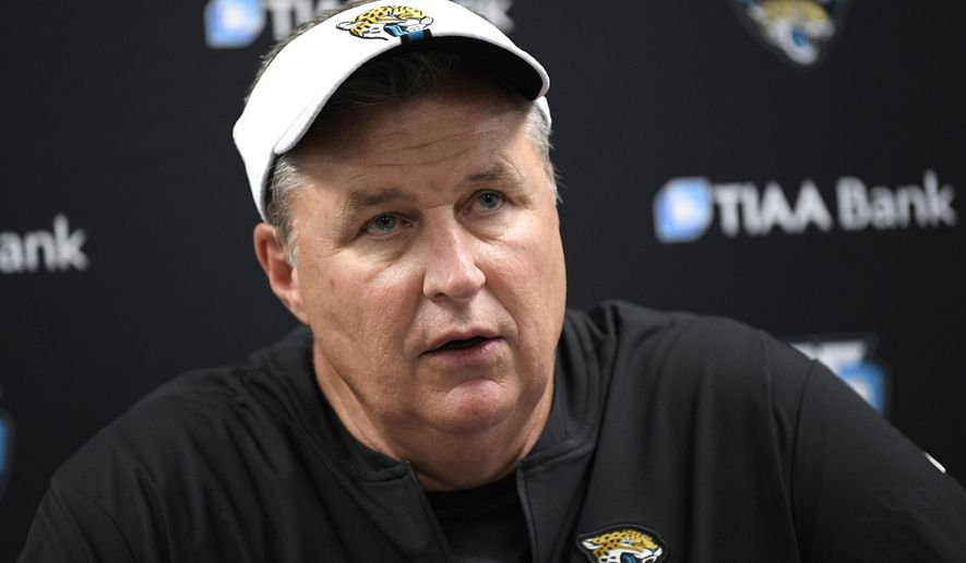 """FILE - In this Aug. 8, 2019, file photo, Jacksonville Jaguars head coach Doug Marrone talks to reporters after an NFL football preseason game against the Baltimore Ravens in Baltimore. Jaguars running back Leonard Fournette insists he's made professional progress. Coach Doug Marrone is hesitant to agree. Marrone says """"we are going to see."""" This much everyone is certain: Fournette's performance on and off the field will go a long way toward determining whether the Jaguars remain at the bottom of the AFC South or return to being conference contenders in 2019. (AP Photo/Nick Wass, File)"""