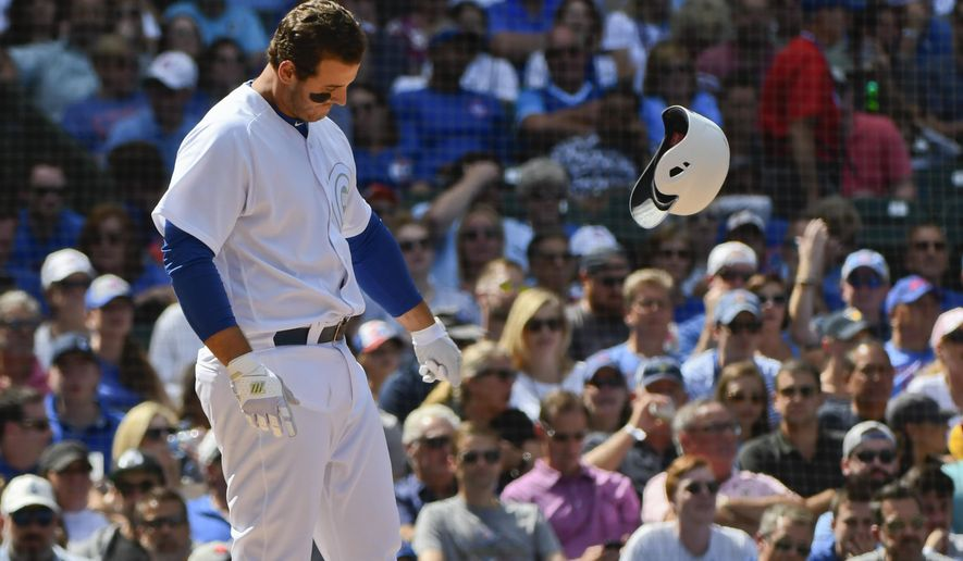 Chicago Cubs' Anthony Rizzo throws his helmet after striking out swinging during the fourth inning of a baseball game against the Washington Nationals, Friday, Aug. 23, 2019, in Chicago. (AP Photo/Matt Marton)