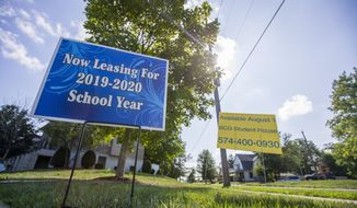 A now leasing sign in the neighborhood near Notre Dame Thursday, Aug. 15, 2019 in South Bend, Ind. Some apartments near the University of Notre Dame are sitting vacant due to a school policy requiring some students to live on campus for six semesters. (AP Photo via Michael Caterina/South Bend Tribune)/South Bend Tribune via AP)