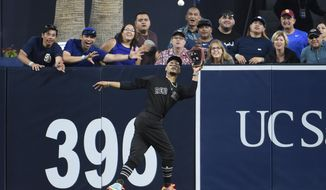 Boston Red Sox center fielder Mookie Betts makes a leaping catch on a ball hit by San Diego Padres' Manuel Margot during the fourth inning of a baseball game Saturday, Aug. 24, 2019, in San Diego. (AP Photo/Denis Poroy)