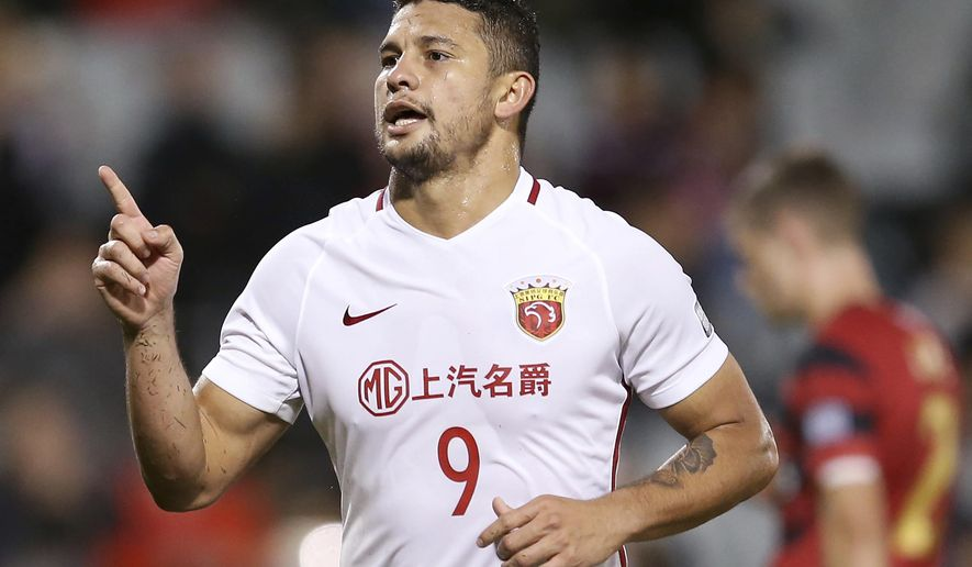 FILE - In this May 10, 2017, file photo, then Shanghai SIPG's Elkeson celebrates after scoring against Western Sydney Wanderers during their Asian Football Confederation Champions League soccer match in Sydney. Brazilian-born striker Elkeson is set to be in the thick of action for Guangzhou Evergrande as the Asian Champions League enters the quarterfinals stage. Elkeson is the talk of Asian soccer after becoming the first player of non-Chinese heritage to be selected for the China national team. (AP Photo/Rick Rycroft, File)