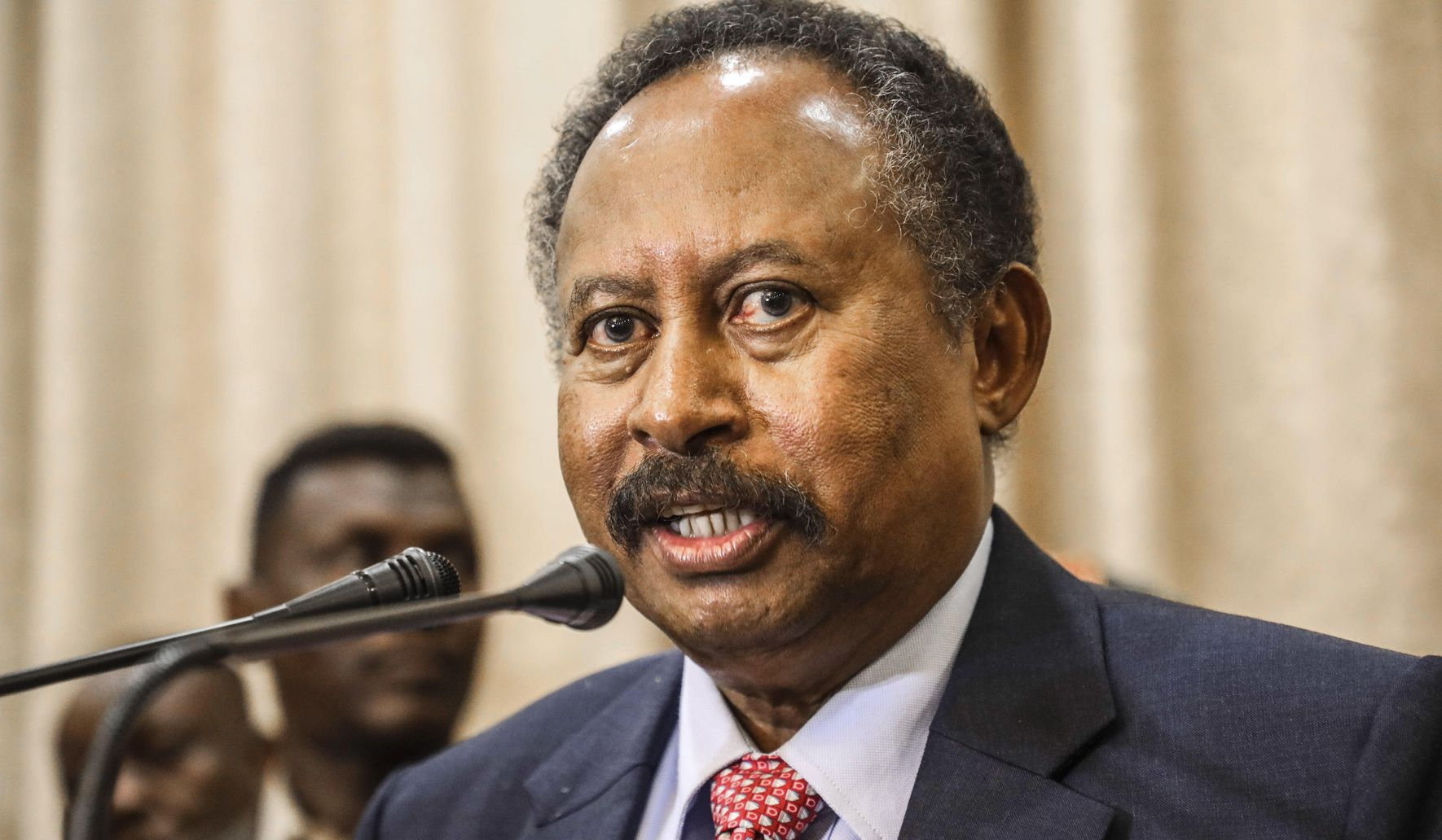 AP Interview: Sudan PM seeks end to country