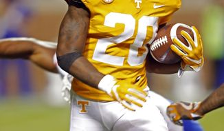 FILE -In this Sept. 22, 2018, file photo, Tennessee's Bryce Thompson (20) returns a kick in the second half of an NCAA college football game against Florida in Knoxville, Tenn. Thompson has been arrested on a domestic assault charge stemming from an argument with his girlfriend. A woman told police the argument began Saturday, Aug. 24, 2019, after she found another woman's fake eyelashes in Thompson's room. (AP Photo/Wade Payne, File)