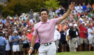 Rory McIlroy waves to the gallery after winning the Tour Championship golf tournament and The FedEx Cup Sunday, Aug. 25, 2019, at East Lake Golf Club in Atlanta. (AP Photo/John Amis)