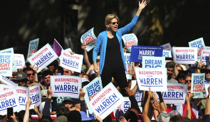 Democratic presidential candidate Sen. Elizabeth Warren speaks to supporters gathered for her town hall campaign event at Seattle Center, Sunday, Aug. 25, 2019, in Seattle. (Genna Martin/seattlepi.com via AP)