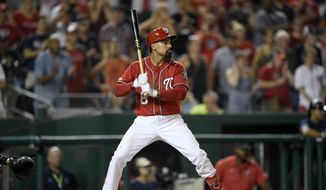 Washington Nationals' Anthony Rendon bats during a baseball game against the Milwaukee Brewers, Saturday, Aug. 17, 2019, in Washington. (AP Photo/Nick Wass) **FILE**