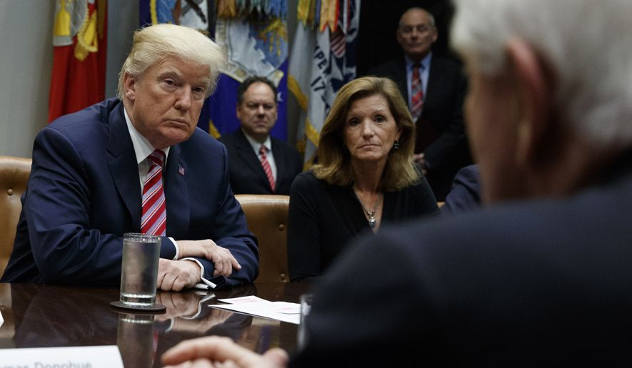 """FILE - In this Oct. 31, 2017, file photo, President Donald Trump listens during a meeting on tax policy with business leaders in the Roosevelt Room of the White House in Washington. At center is Karen Kerrigan, President and CEO, Small Business & Entrepreneurship Council. At right is Tom Donohue, President and CEO, U.S. Chamber of Commerce. Although President Donald Trump has ordered U.S. companies to stop dealing with China, small business owners say complying would hurt, even devastate, their companies. """"It's not as easy as a tweet to find alternatives. And time spent finding alternatives is time spent not growing the business,"""" says Kerrigan. (AP Photo/Evan Vucci, File)"""