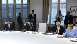 From the left, French President Emmanuel Macron, Egyptian President and Chairman of the African Union Abdel Fattah al-Sissi, Chile's President Sebastian Pinera and German Chancellor Angela Merkel attend a work session focused on climate in Biarritz, southwestern France, Monday Aug. 26, 2019, on the third day of the annual G7 Summit. The empty seat at third right was the place reserved for President Donald Trump, who according to Macron had skipped Monday's working session on the climate. At the same time Macron said that Trump supported an initiative by G-7 countries for an immediate $20 million fund to help Amazon countries fight wildfires and launch a long-term global initiative to protect the rainforest. (Ludovic Marin, Pool via AP)