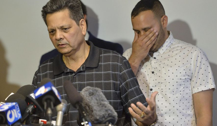 Kevin French react as his father, Russell French, describe the family's ordeal during a news conference in Corona, Calif., Monday, Aug. 26, 2019. Russell and his wife, Paola French, were shot by an off-duty LAPD officer in the same incident where their son, Kenneth French, was killed by the same officer at a Costco in June. (Jeff Gritchen/The Orange County Register via AP)
