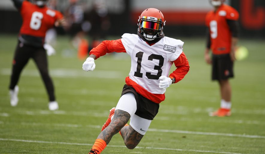 FILE - In this June 4, 2019, file photo, Cleveland Browns wide receiver Odell Beckham Jr. runs a drill at the team's NFL football training facility in Berea, Ohio. Beckham Jr. took part in team drills during practice for the first time in nearly three weeks, Monday, Aug. 26, 2019. (AP Photo/Ron Schwane, File)