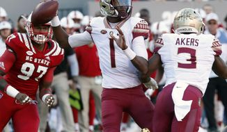 FILE - In this Nov. 3, 2018, file photo, Florida State's James Blackman (1) looks to pass during the first half of the team's NCAA college football game against North Carolina State in Raleigh, N.C. Blackman is back under center for Florida State's opener against Boise State after not winning the quarterback competition in 2018. (AP Photo/Chris Seward, File)