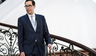 Treasury Secretary Steve Mnuchin walks to a working breakfast with President Donald Trump and Britain's Prime Minister Boris Johnson at the Hotel du Palais on the sidelines of the G-7 summit in Biarritz, France, Sunday, Aug. 25, 2019. (Erin Schaff, The New York Times, Pool)