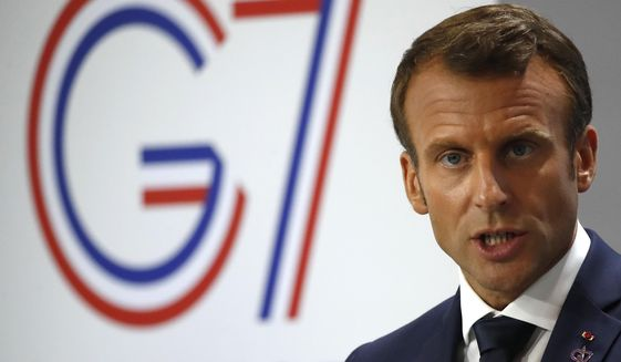 French President Emmanuel Macron speaks during his final press conference at the G7 summit Monday, Aug. 26, 2019 in Biarritz, southwestern France. (AP Photo/Francois Mori)