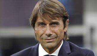 Inter Milan's head coach Antonio Conte smiles before the Serie A soccer match between Inter Milan and Lecce at the San Siro stadium, in Milan, Italy, Monday, Aug. 26, 2019. (AP Photo/Luca Bruno)