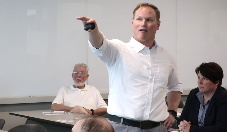 U.S. Rep. Steve Watkins, R-Kan., makes a point during a town hall meeting, Monday, Aug. 26, 2019, in Topeka, Kan. Watkins is getting heat from some frustrated constituents who want him to publicly endorse tougher gun-control measures in the wake of recent mass shootings. (AP Photo/John Hanna)