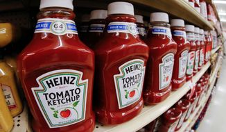 FILE- This Feb. 21, 2018, file photo shows a display of Heinz Ketchup on display in a market in Pittsburgh. Kraft Heinz Co. is bringing back its former chief financial officer amid accounting problems and falling sales. Paulo Basilio, joined H.J. Heinz as CFO in 2013 and remained in the job after the company's 2015 merger with Kraft. He most recently served as Kraft Heinz's chief business development officer. (AP Photo/Gene J. Puskar, File)